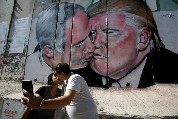 Another Donald Trump mural believed to be the work of Australian graffiti artist Lushsux has popped up on Israel's barrier in the occupied West Bank, this time depicting the U.S. president sharing a kiss with Israeli Prime Minister Benjamin Netanyahu.