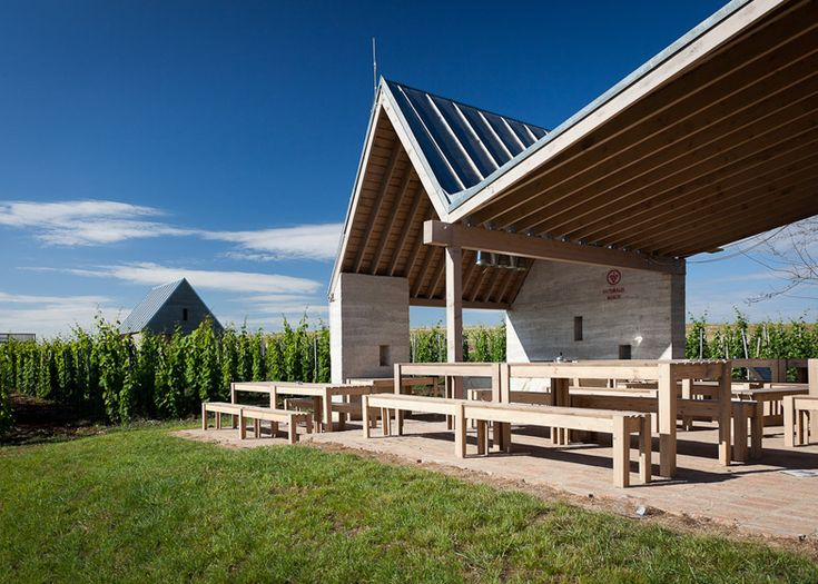 Earthy cabins hide amongst the vineyards at the Almagyar Wine Terrace in Hungary.