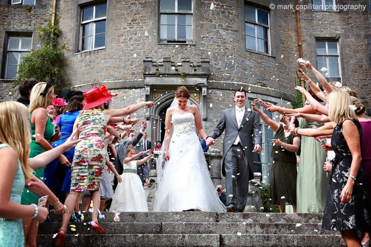 Bride & groom with confetti at Markree Castle Ireland wedding photographer Sligo