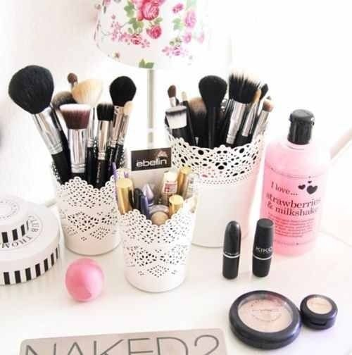 Easy, pretty makeup organization. You can use plastic cups and decorate them with lace for a similar effect!