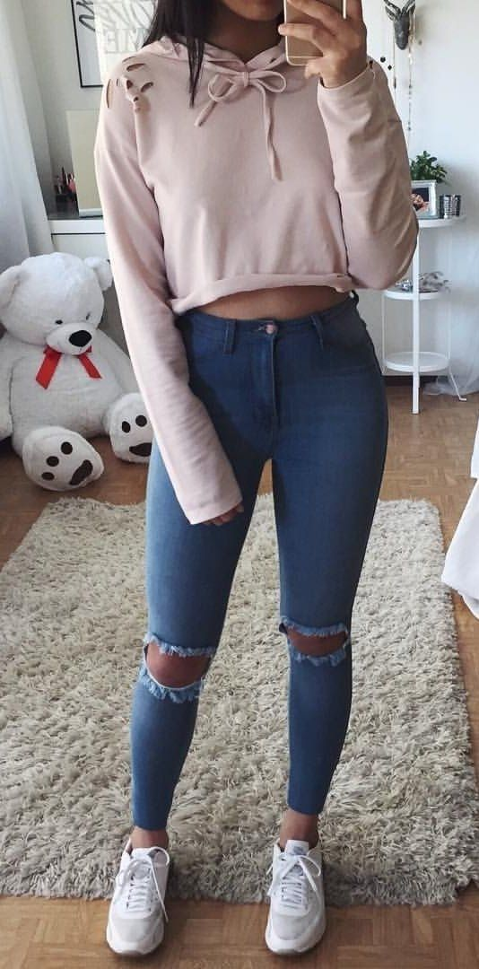 03b86fb9d408 #winter #outfits beige pullover hoodie crop top, distressed blue denim  skinny jeans and white sneakers outfit