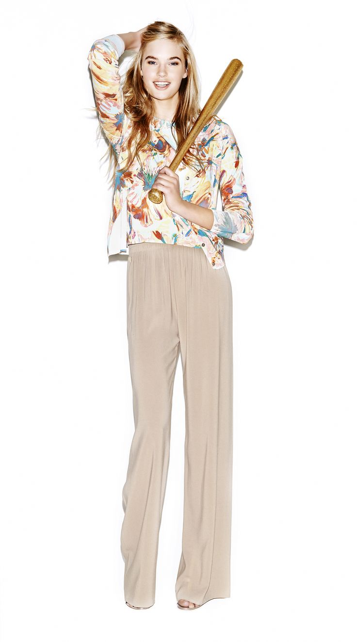 Model wears Naughty Dog flower print short-sleeve cotton blouse; one matching opened cardigan; wide leg pants made in silk fabric.