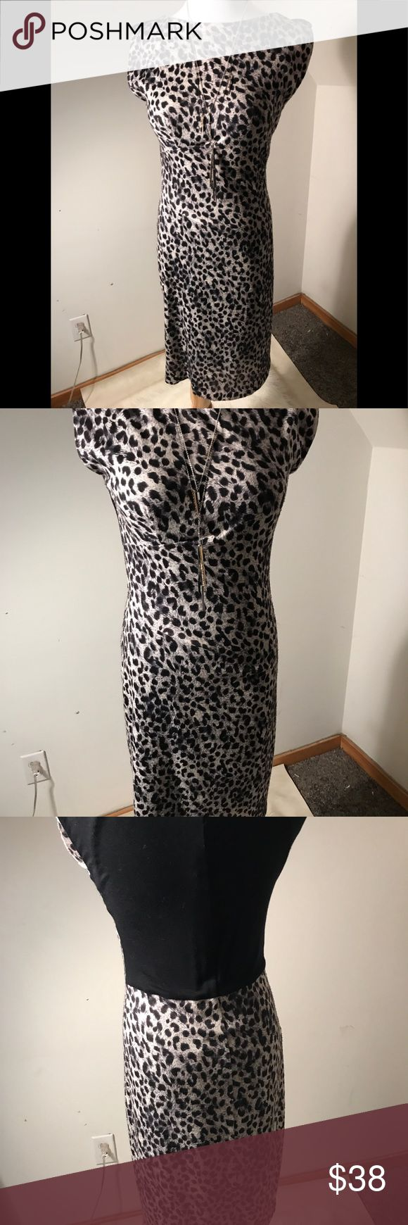 """Rebecca Taylor cheetah dress Rebecca Taylor sexy wear to work  cheetah dress. Approximate Dimensions are 35"""" Length, 33-34"""" Chest....the knit Fabric has some stretch & give & a Full mesh lining.  Some strategically placed darting/shirring on right side that helps hide tummy.  Very good condition w/ one minor flaw... about a 3-4"""" spot in hem that needs tacking- see last pic. Rebecca Taylor Dresses"""