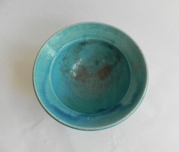 This is, in my opinion, Danish pottery at its best:-)  Beautiful slipware blue glaze stoneware bowl in traditional Kähler style - but actually made about 20 years ago by ceramicist Anette Christiansen. Her glazing technique is fabulous and the shimmery blue slipware on this rough piece of stoneware just takes my breath away. I hope that someone will enjoy it as much as I have during the years.  Anette is a wonderful potter; trained at Lillerød Lervarefabrik (1893-1995) in the late 1970´s…