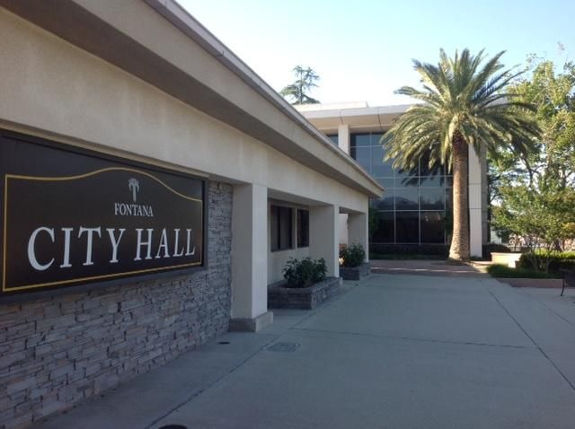Fontana City Hall is located at 8353 Sierra Ave in Fontana and is home to  the offices of Mayor and Council, City Manager, City Clerk, Management Services (Accounts Receivable / miscellaneous billing, Finance, Business License, Animal licenses, Franchise services, Parking tickets, Passport services, Sewer billing & Yard sale permits), Economic Development, and the Housing Authority.