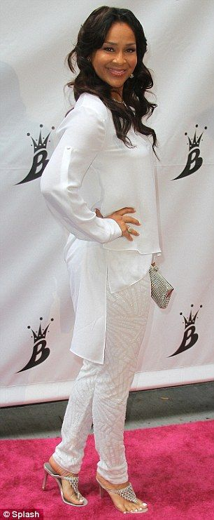 Actress Lisa Ray, dressed in all white