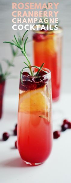 Cranberry Rosemary Champagne Cocktails are a festive, fizzy, not-too-sweet cocktail that's perfect for the holidays. The ombre color, green rosemary sprigs, and ruby-red cranberries make them especially pretty to serve, too.  #champagne #cocktail #christmas #ombre