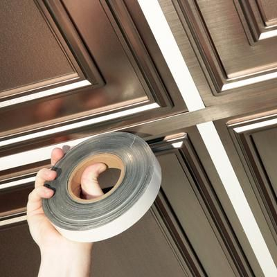 <3 deco-faux tin tape for dropped ceilings! What a fabulous idea for updating and a way to improve the aesthetics of t-bar!