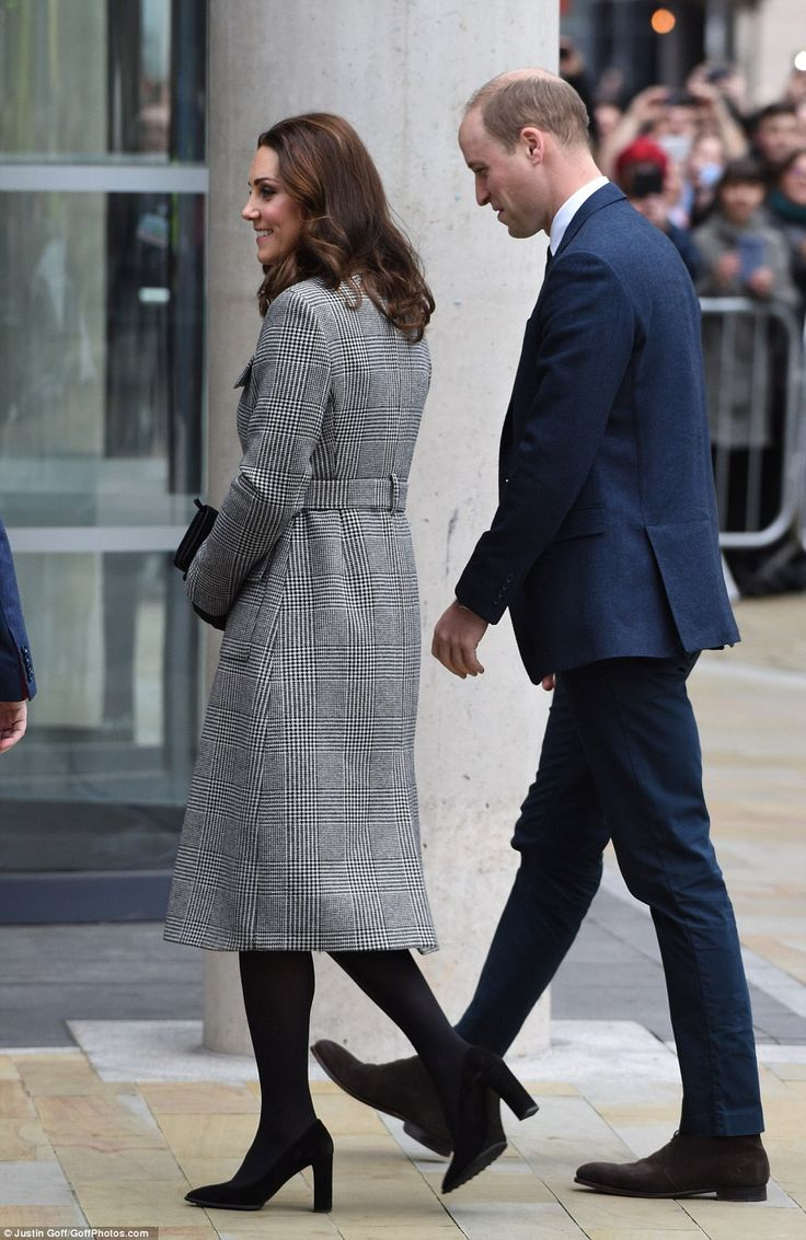 The Duchess was wrapped up warm against the winter chill, teaming her outfit with block he...
