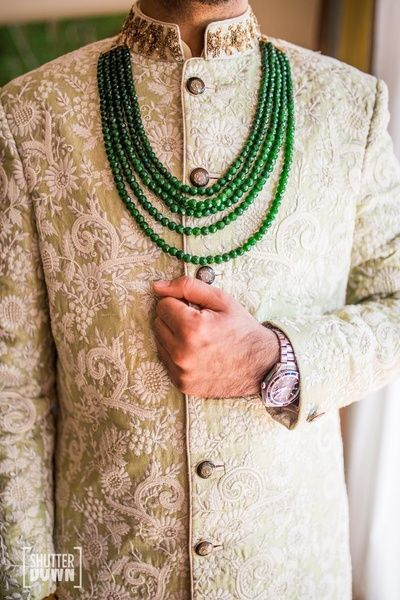 Groom Wear - Groom in a Threadwork Sherwani and Emerald Necklace | WedMeGood #wedmegood #indiangroom #indianwedding #threadwork #sherwani #emeralds #groomwear #indiangroomwear