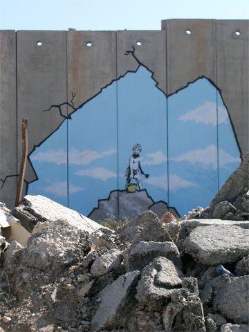 Tekening van de Britse graffitikunstenaar Banksy nabij de Qalandia controlepost…
