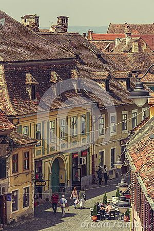 Sibiu, Romania - 06 May, 2015: Unidentified people stroll the cobblestone streets in the medieval Lower Town of the old city of Sibiu, ranked as Europe's 8th most idyllic place to live by Forbes.