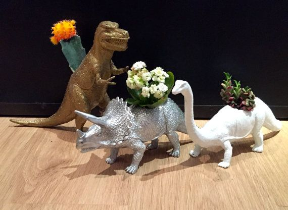 Made to order dinosaur planters! These are unique pieces for home decor, and make great gifts!  You may choose the type of dinosaur, type of plant