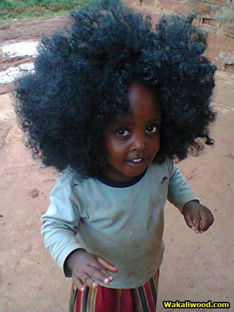 queerfabulousmermaid:  fuckyeaafricans:  Uganda wakaliwood.tumblr.com  this baby has more hair than i do