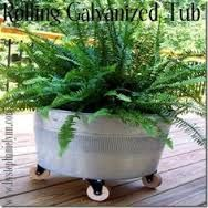 turn rubbermaid tub into planter google search - Rubbermaid Tubs