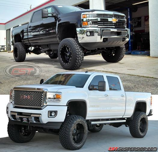 Two Lifted Chevy trucks all black and all white