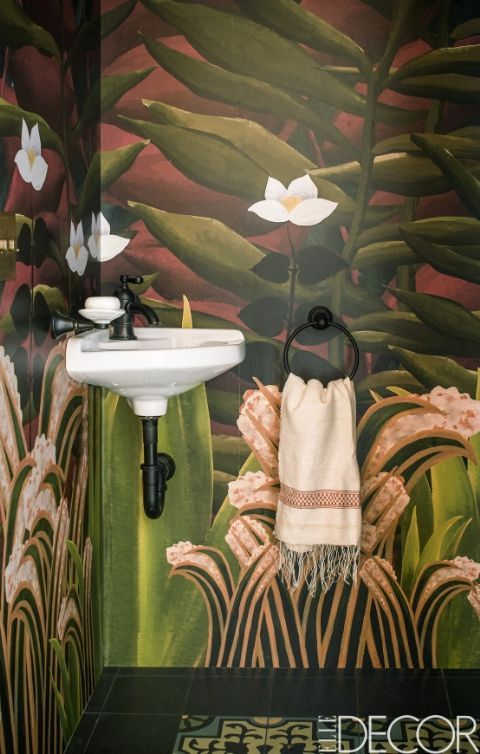 Make a powder room appear larger by adding in stunning wallpaper.