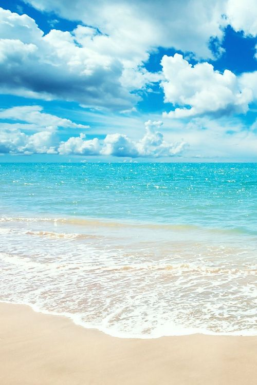 Relaxing photo of a beach. The bright colours of the water and sky combined with the sandy beach is very calming and lets your mind drift away for a little bit.