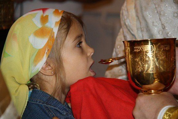 Russian Orthodox Church - child receiving Holy Communion