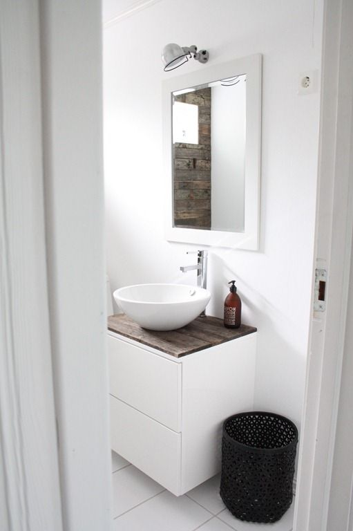 IKEA cabinet for bathroom with reclaimed wood planks for countertop. Vessel sink and industrial light fixture ♥