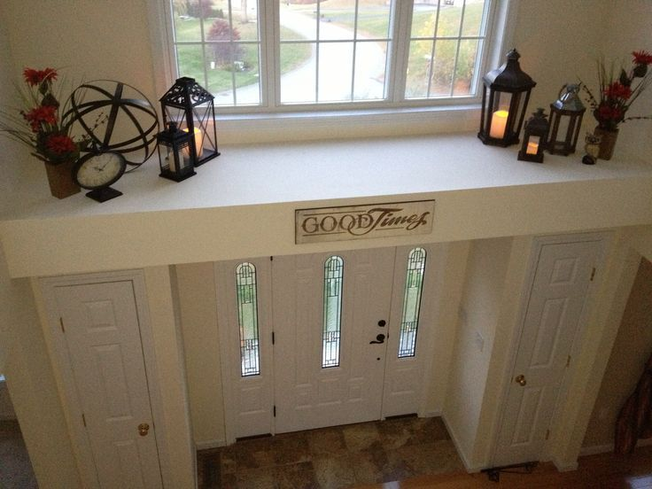 Plant ledge idea: lanterns with remote control battery candles. decorating ideas ledge above front door ...