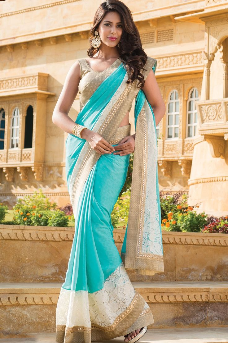 Sky blue plain georgette designer saree in golden shimmer blouse & sky blue plain pallu along with white & gold saree border.