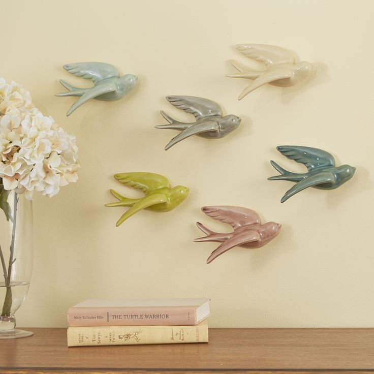 Swallows Wall Decor | Showcasing a set of six ceramic swallows in an array of hues, this colorful flock transforms your walls into an artful focal point.