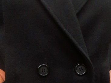 A heavy stylish winter wool coat from C&A. Full lining in a straight cut, padded shoulders, double breasted, two pockets, wide lapels and top quality. In mint condition.