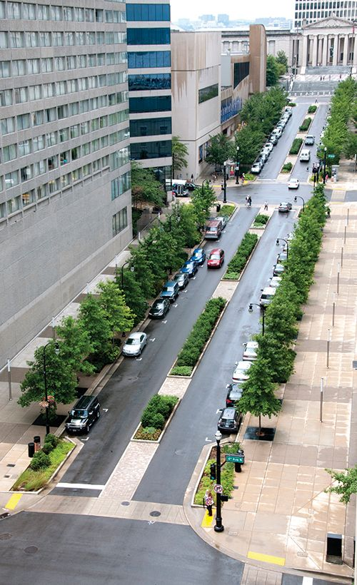 Para a estrada parque Deaderick Street :: Nashville, TN Bioswales, medians, sidewalk planters and pervious concrete pavement over structural soils divert 1.2 million gallons of stormwater from going into the Cumberland River