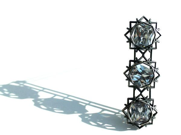 Lindsay Hill, Glasgow School of Art - 'Three Stone' – brooch in oxidised silver with kinetic cubic zirconia