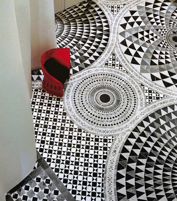 Italian Floor Mosaic (This design is a little too busy for me, but I love the idea of taking one of the circles and using it in a room with a plain-ish border.)