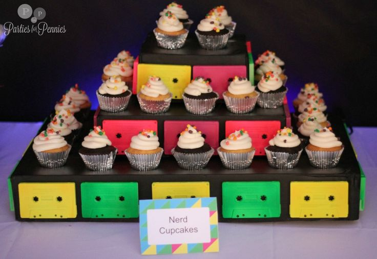 80s Party - nerd cupcakes on a cassette tape cupcake stand by PartiesforPennies.com (click on the picture for more 80s party ideas)