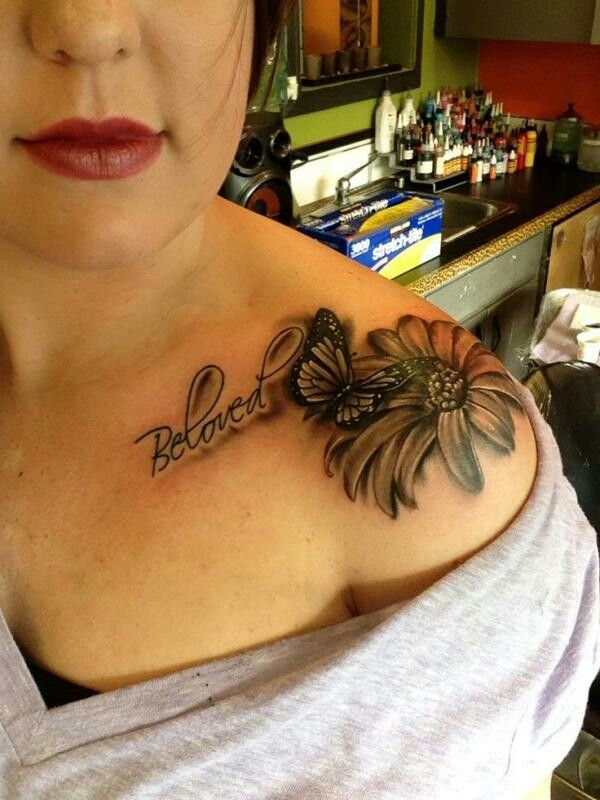Daisy & butterfly  shoulder tattoo