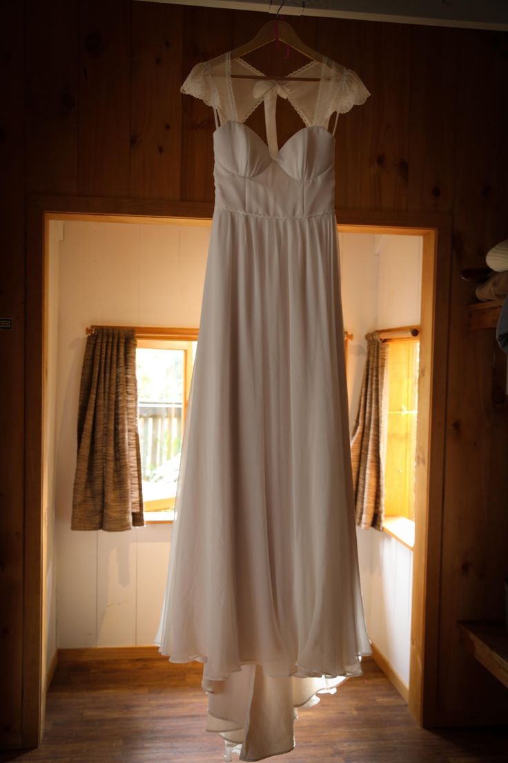 Floaty and light wedding dress with capped sleeve detailing. www.hushaccommodation.co.nz www.sallyeagle.co.nz