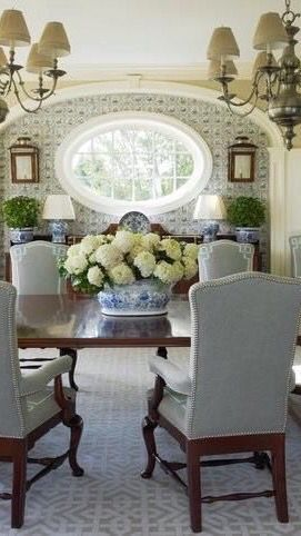 unusual oval window, wallpaper, dark wood antiques, blue + white porcelain #traditionaldiningroomideas