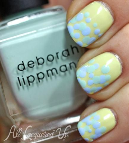 Even a nail art novice can pull off this pretty pastel nail design with layered dots on a soft green background. Perfect for spring! #nails #nailart #manicure #pastel