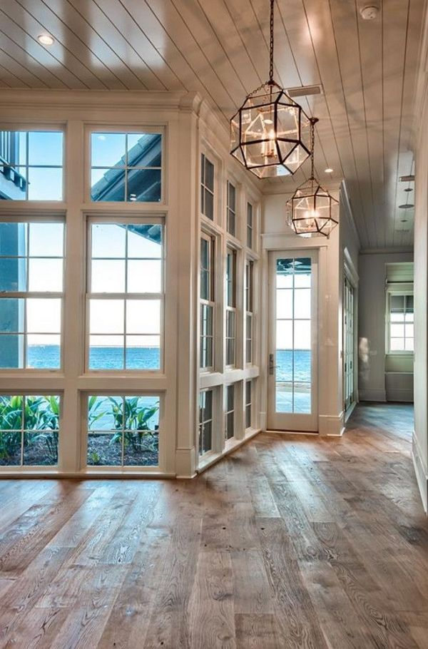 Beach house with reclaimed hardwood floors | Urban Grace Interiors by delia