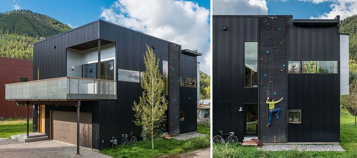 Black corrugated metal and a rock climbing wall cover the exterior of this home.