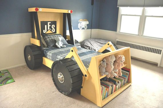 "Construction Truck Bed Plans - perfect for a toddler construction themed room! Help your little boy or girl transition from the crib into a bed he or she will actually enjoy sleeping in. Theyll love it!  This document is a design guide with step-by-step instructions to create the ""Construction Truck Bed: Wheel Front Loader Model."" Included are a Bill of Materials, exact dimensions for the components, a step-by-step guide for assembling the bed, a recommended cutting guide, and lots of visual…"