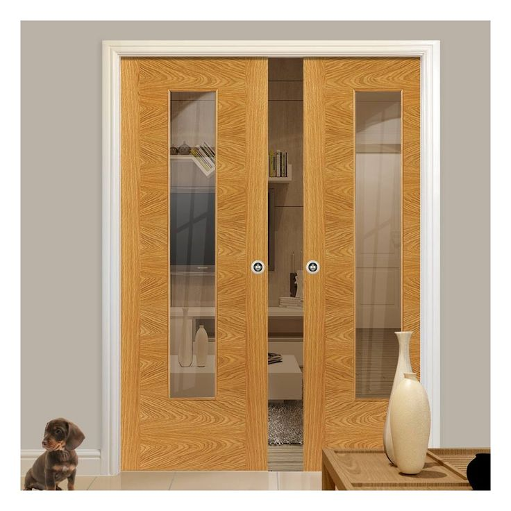 Double Pocket Brisa Ostria Oak sliding door system in three size widths with clear glass. #oakpocketdoors #glazedpocketdoors #modernpocketdoors
