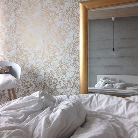 Wilderness Gold wallpaper in this sophisticated yet restful bedroom
