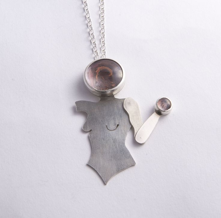 Silver pendant with copper and glass stone settings and moving arm by Rosita Bailey-Rosse
