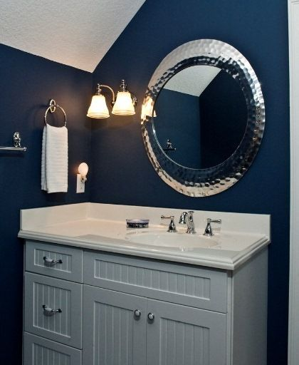 Vintage Wall Sconce Adds Elegance To Bold, Blue Bathroom #bathroom #lighting