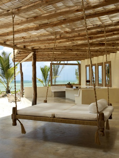 I can feel the sea breeze from here...Swinging day bed on beach house porch...