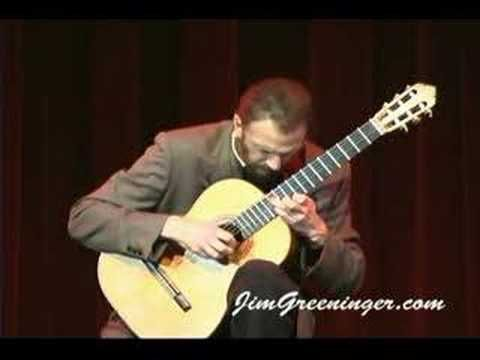 Recuerdos de La Alhambra (Memories of the Alhambra) by Francesco Tarrega-Performed by Jim Greeninger---This is hands down the most beautiful guitar piece I have ever heard! Please listen to it! The composer wrote it in remembrance of the Moorish 13th century palaces and gardens, The Alhambra in Granada, Spain. Mr. Greeninger's tremelo is almost perfectly spaced and even and he has beautiful, long, calm musical lines. Gorgeous.
