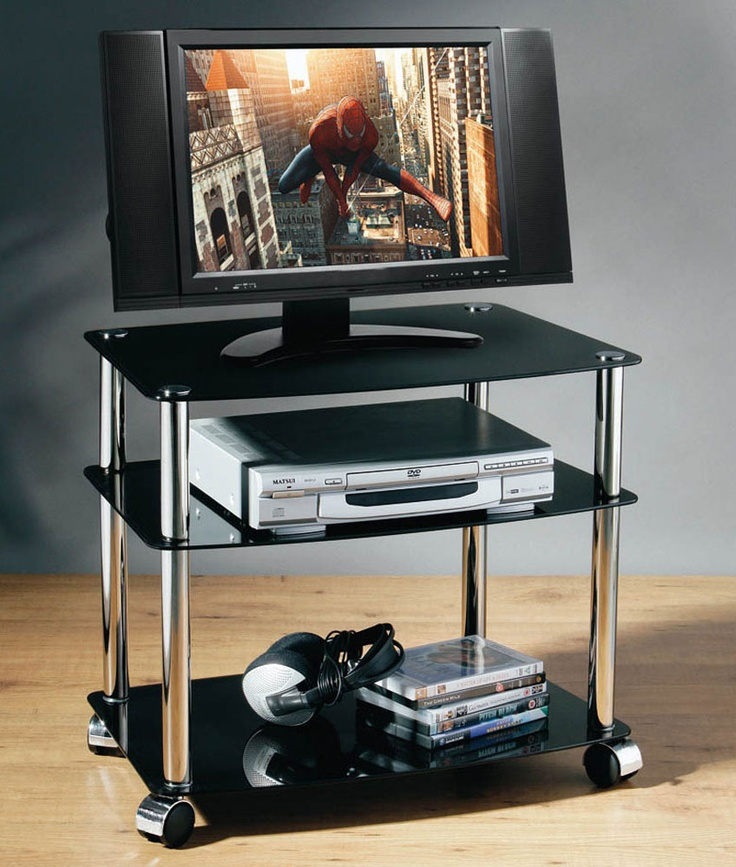 Sleek, black glass TV stand.  http://www.worldstores.co.uk/p/Black_Glass_TV_Unit.htm