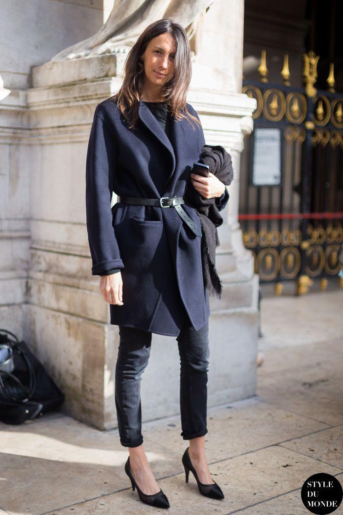 Geraldine Saglio in a belted black coat + black tee + black skinny jeans + black heels