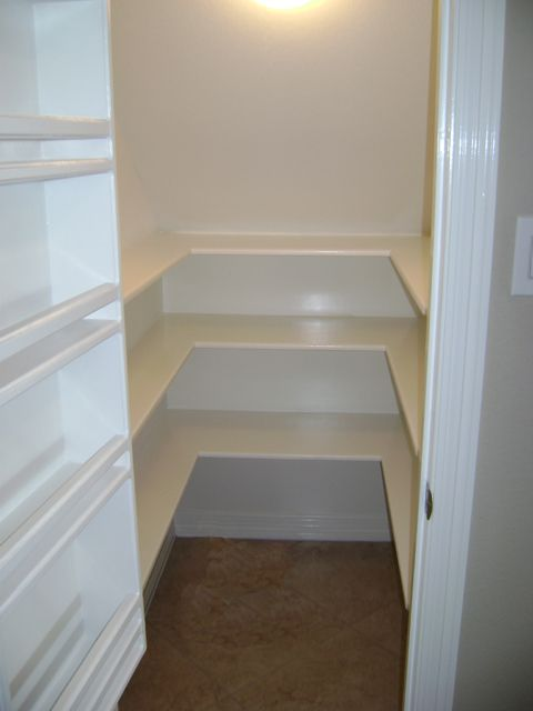 Pantry under the stairs, getting shelving ideas.