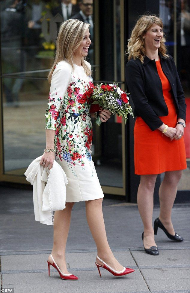 The Dutch Queen teamed her floral dress with a pair of red slingback stilettos with white trim