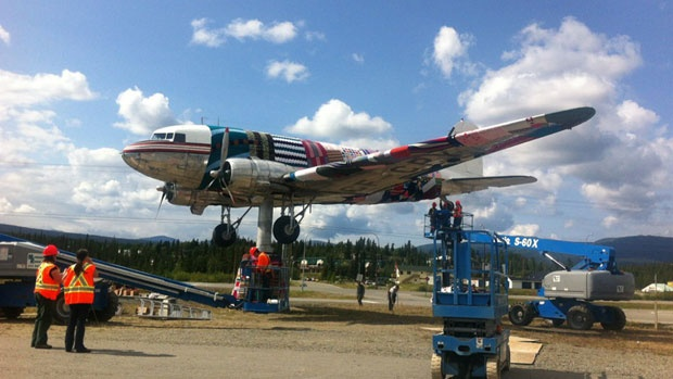 Knitters in Whitehorse covered a Second World War-era airplane that sits on a platform outside the Yukon Transportation Museum in yarn on Saturday August 11, 2012